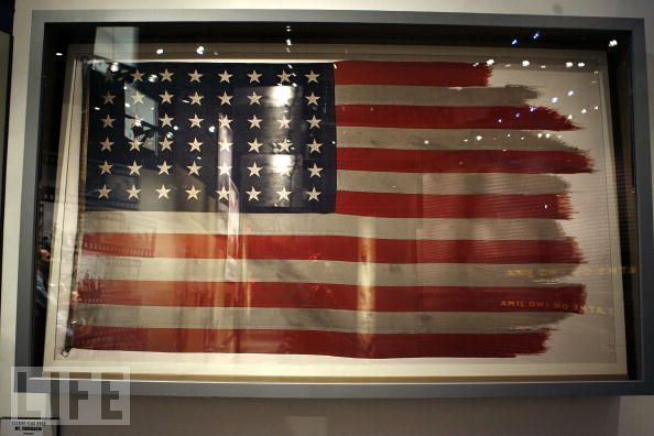 """The flag raised during the WWII Battle of Iwo Jima and made famous by  Associated Press photographer Joe Rosenthal is on display at the  National Museum of the Marine Corps November 2, 2006 in Triangle,  Virginia. The museum is set to open to the public on November 10 with  118,000 square feet of interactive and multimedia exhibits and actual  aircraft, weapons and armored vehicles."""