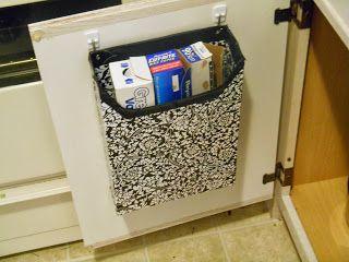 Organizador de armário feito com caixa de cereal forrada com tecido