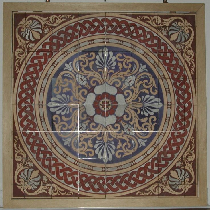 Floor panel: sixty-four deep sandwich tiles, red earthenware between buff, inlaid with red, white, blue and brown. The design features a circle with a chainwork border enclosing anthemions and scrolls, with a stylized rose in the centre. Makers mark on reverse of all sixty-four tiles and Minton date codes on nine tiles.