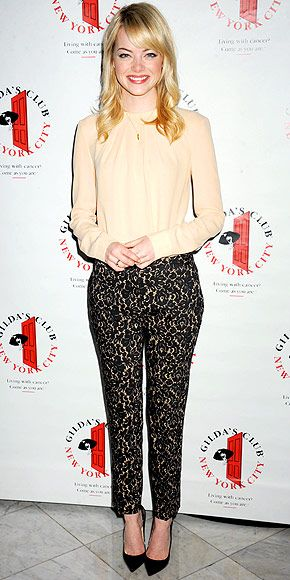 EMMA STONE  Prim and proper are the words that come to mind when we look at Emma in this Michael Kors ensemble, a pair of black lace trousers and a pleated blouse, selected for the Gilda's Club Benefit in N.Y.C.