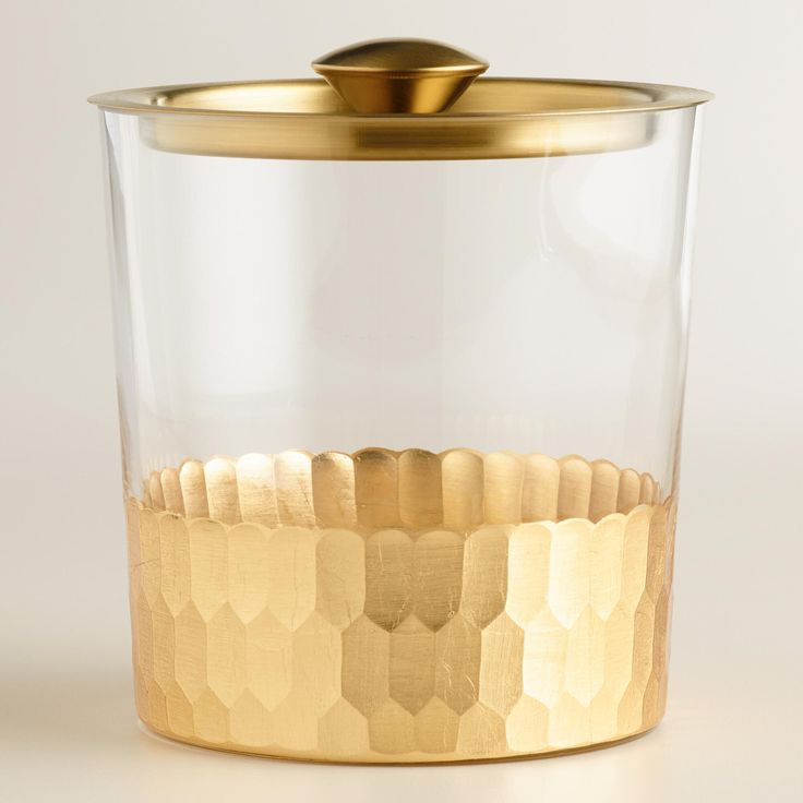 Conveniently serve your guests from our glass ice bucket complete with a lid and tongs, featuring luxe faceted gold metal detail along the bottom. >> #WorldMarket New Year's Entertaining