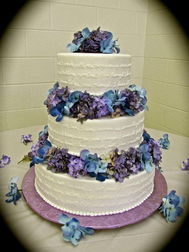 Wedding cake with 1st corinthians 13 hand written around it.