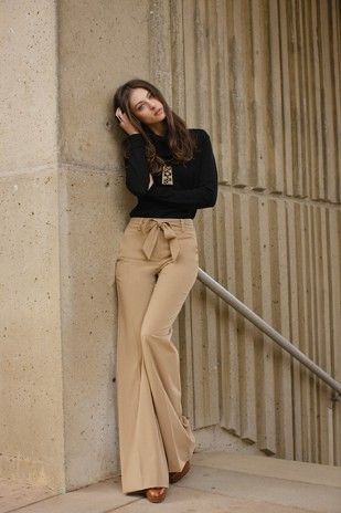 Bow tie, sailor inspired, high waisted pants.