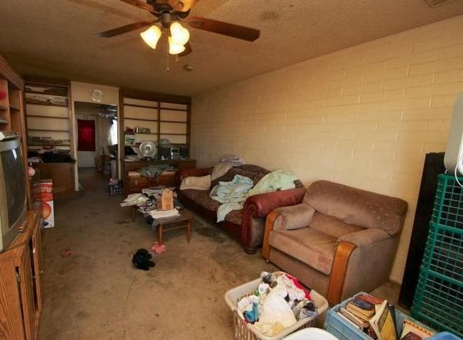 cluttered messy family room dirty soiled stained filthy disgusting carpet poor bad home staging Mesa Arizona house for sale