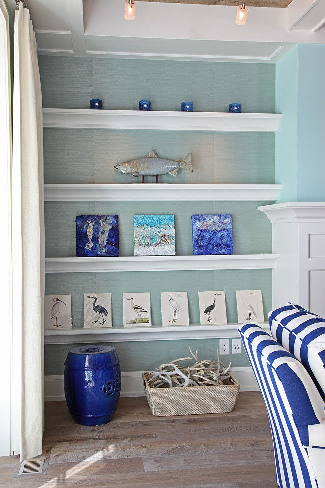 Good Coastal Living Room With Coastal Art In Fireplace Bookcase. Fireplace  Bookcase Features A Turquoise Wallpaper