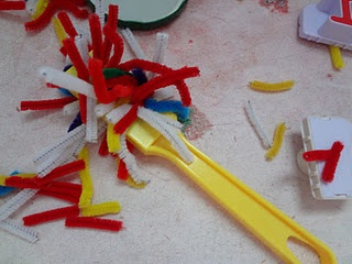 cut up pipe cleaners in the magnet sensory table