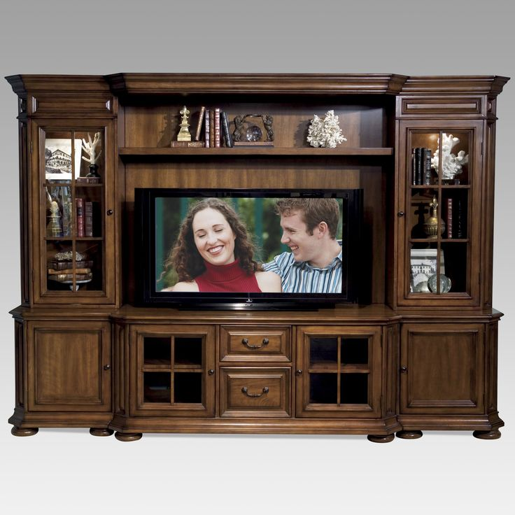 Have to have it. Riverside Cantata Cherry 60-Inch Media Entertainment Center – $3879 hayneedle.com