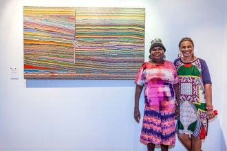 Selena Brown with her painting. Photograph by Bewl