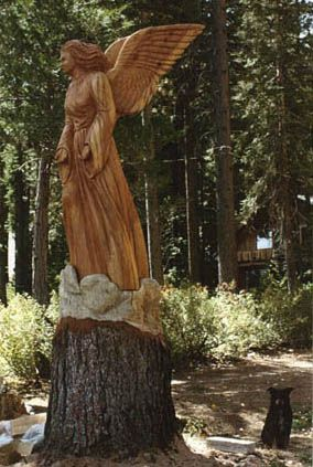 chainsaw wood carving - spiritually beautiful and peaceful. Would be outstanding in a cemetery or church setting.