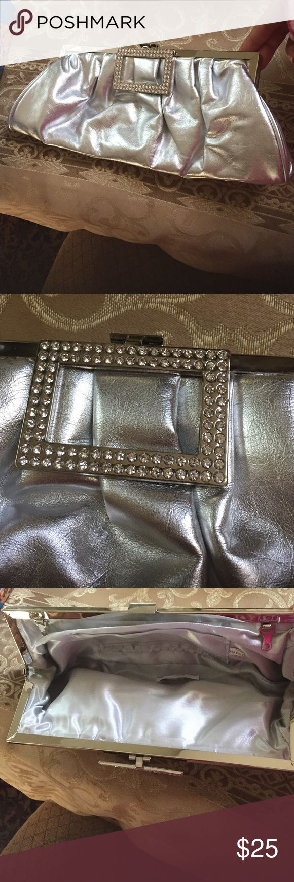 C Silver clutch + silver rhinestones!TAKING OFFERS Silver clutch with silver rhinestones on the clip ! Pocket inside . Great condition ! Color silver !👛🎉🎉🎉! TAKING REASONABLE OFFERS Bags Clutches & Wristlets