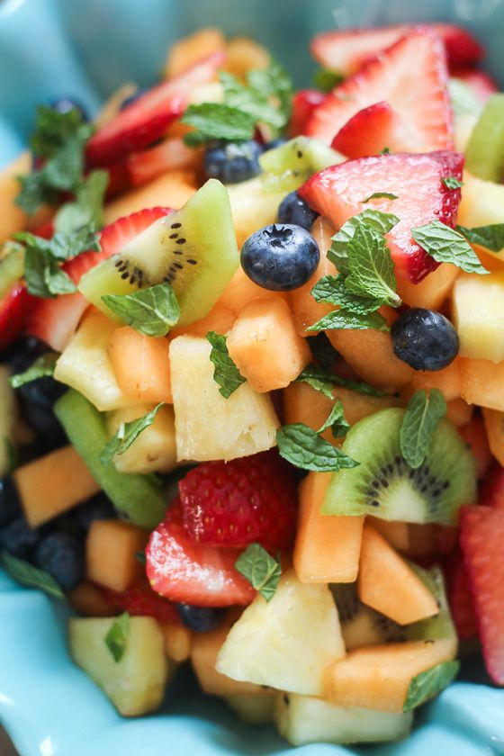 Best Ever Boozy Fruit Salad Recipe ~ this wonderful concoction is made up of cantaloupe + blueberries + strawberries + kiwi + pineapple, then soaked in Limoncello and garnished with fresh herbs
