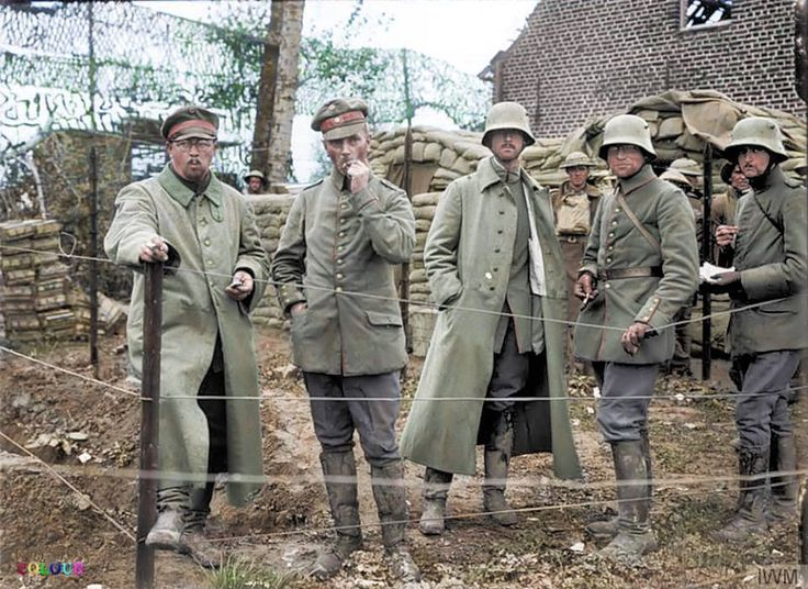 During the Third Ypres offensive, in the Battle of Broodseinde, Passchendaele Area in Belgium on the 4th of October 1917.   A German Regimental Commander, second from the left, with his Adjutant and Staff being held as prisoners of war in an enclosure at St Jean. This group were captured in a dugout at Poelcapelle.
