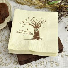 Mr and Mrs Love Tree cocktail napkins showcase a whimsical autumn tree with falling leaves featuring a carved heart silhouette around the letters 'Mr. + Mrs.'. Two lines of text are custom printed below the tree limbs to include the bride and groom's name and wedding date or a special message or phrase. These napkins can be ordered at http://myweddingreceptionideas.com/fall_tree_personalized_wedding_cocktail_napkins.asp