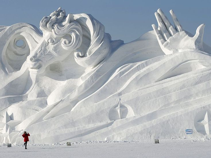 Harbin Ice and Snow Festival, China:  A colossal snow sculpture, built in advance of the Harbin Ice and Snow Sculpture Festival in China, dwarfs a woman posing for a snapshot. The annual event showcases ice and snow carvers and features ice skating, illuminated ice displays, and a polar plunge for the hardy. Photograph by Kim Kyung-Hoon, Reuters/Corbis, January 22, 2014