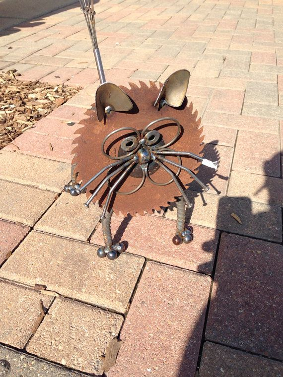 Cat Recycled Garden Art Sculpture by nbillmeyer on Etsy awesome stuff-saw it in real life in I; this has a saw blade, re-rod, 2 small trowels for ears-designs are amazing. Cute on porch, in yard, sunroom, office, etc
