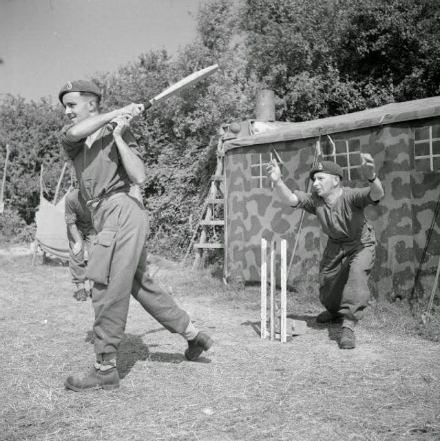 World War II Brits play cricket in France, 1944.
