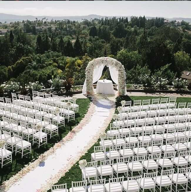 By far one of the most beautiful wedding ceremonies we've seen! We love the flower petal lined aisle by Details Details!