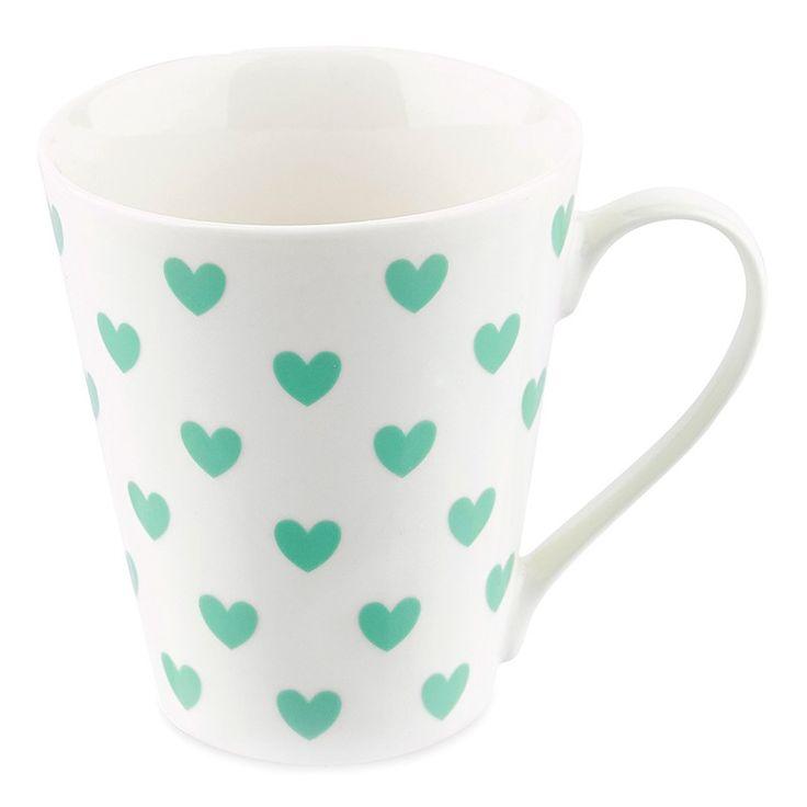 Taza de cerámica blanca con asa, decorada con corazones verdes. De gran calidad, es ideal para servir leche, café, infusiones. Gracias a su elegante diseño, también puede ser usada para decorar la mesa con flores, cubiertos...