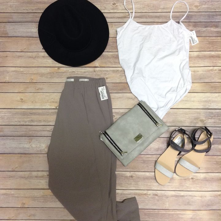 What better way to celebrate #Sundayfunday than by wearing the cutest outfit in your closet? You'll look effortlessly chic in this ensemble while you catch up on some much needed chill time! #shoppingismycardio #easybreezy #PlatosClosetNewmarket // Hat, $6 // #Zara #NWT bodysuit, Size M, $12 // #Babaton pants, Size M, $16 // #CalvinKlein shoes, Size 5.5, $12 // purse, $10 // | www.platosclosetnewmarket.com