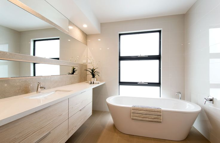 Glebe Display Home by Classic Constructions at Googong, NSW. Features BetteStarlet Freestanding Oval Bath, Argent Essential Freestanding Bath Spout and Grohe Concetto Bath Mixer. For more inspired ideas visit southerninnovations.com.au