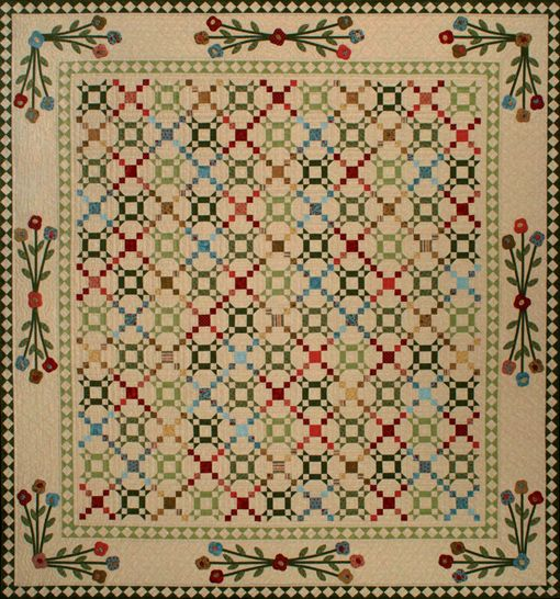 I like this. A lot. Pattern by Kim Diehl. I'd do a different appliqué in the border. (Can see this done up as a spring quilt, reminds me of garden pathway.)