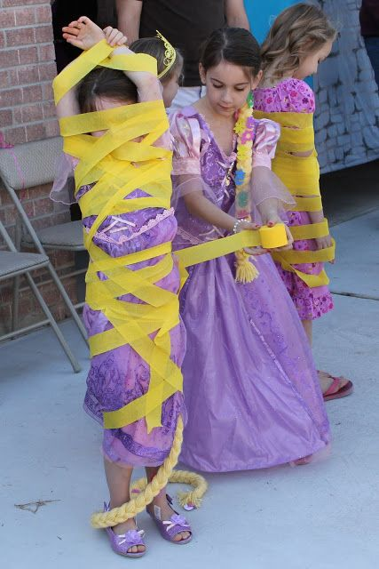 Tangled party games | we played a Tangled game where each girl got a partner and they had to tangle their partner in yellow crepe paper in the allotted time! The judges decided which girl was the most Tangled and then they switched and let the other partner get Tangled!