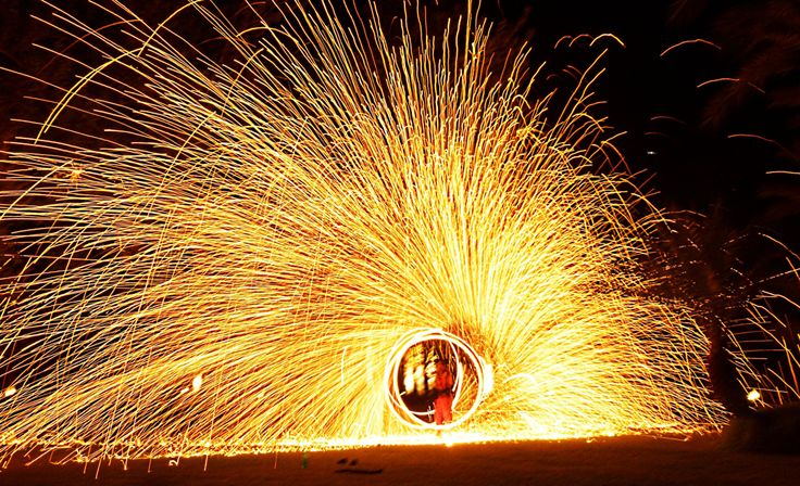 I have seen many people play with fire pois, fire juggling balls, fire chains. I have never seen this before in Morocco. Fire pois with copper shavings that burned in the air. Looks like someone ou...