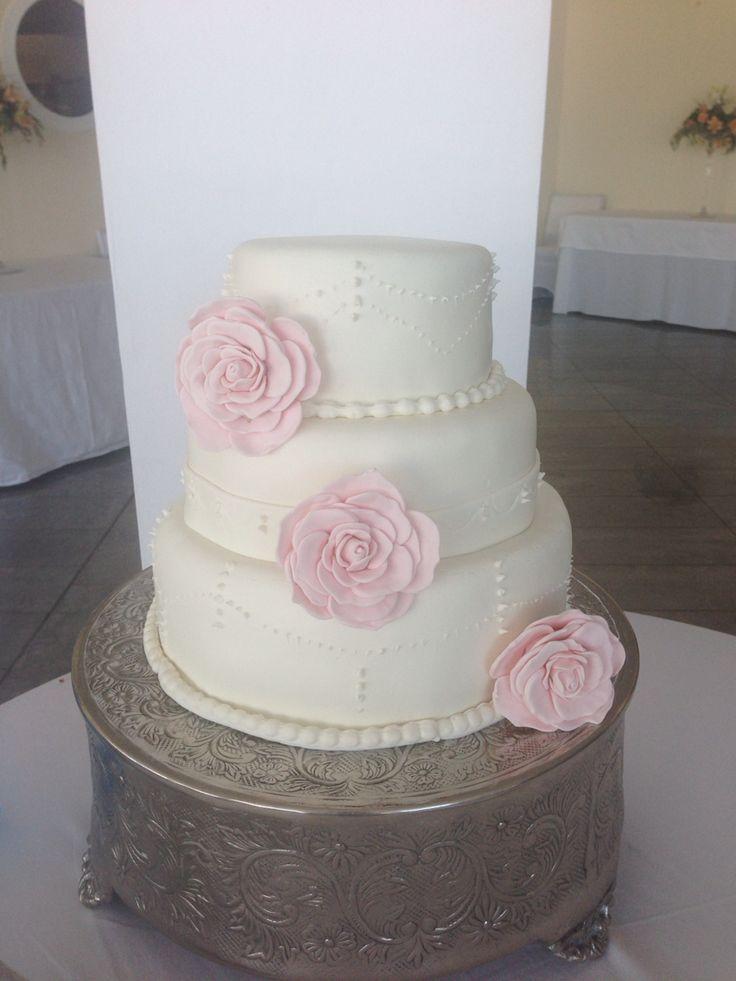 Pink roses wedding cake white
