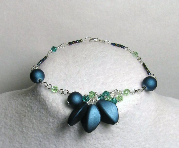 Item 1390a - Beautiful Teal Polymer Bud Beads, Swarovski Peridot & Emerald Crystals Bracelet PROMO OFFER $30 + s&h. (REGULARLY $34 + $4 S&H.) (SEE MATCHING NECKLACE). Designs by LK...Visit all my BEAUTIFUL jewelry pages, just follow the link: https://www.facebook.com/linda.foust.9?sk=photos...