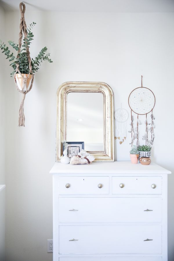 bedroom before and after, bedroom makeover, boho bedroom, bohemian bedroom, light and bright home decor, apartment decor, hanging plant, macrame plant holder, white dresser, white bedroom, anthropologie knobs, gold mirror, dream catchers