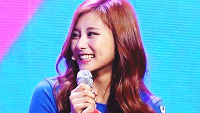 This is a gif of Tzuyu from the Kpop girl band TWICE. .