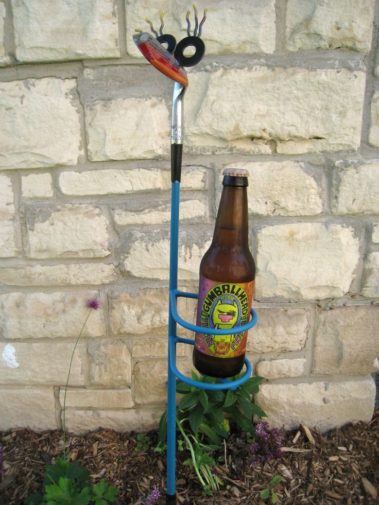 """Blue Lagoon - Golf Club Guy Drink Holder: This little guy is made from a recycled """"Northwestern Golf Company"""" Tournament Model golf club.  I've added rings to hold your drink or even a small flower pot.  He has a lagoon blue shaft and rings.  Will fit a drink in a foam koozie comfortably."""