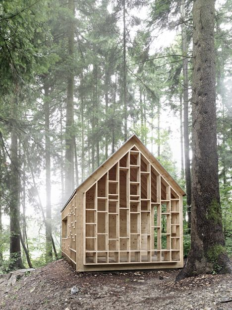 This see-through timber cabin offers shelter for a forest kindergarten.