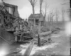 WWI, March 1917; Troops of the Royal Engineers replacing a blown up bridge on the Somme River, Peronne. ©IWM (Q 5018)