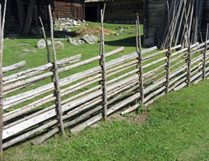 "A ""gärdsgård"" is a wooden round pole fence typical for Sweden. It is usually made of non-decorticated and non-split young spruces or of tops of spruce trees. The fence consists of upright poles in pairs held together with linings of osier. Between the upright poles there are diagonally laid round poles, with the top end facing the ground. The length of the diagonal poles was about 4 meters (13 feet). The fence is usually 1.5 to 2 meters tall (5 to 6.5 feet)"