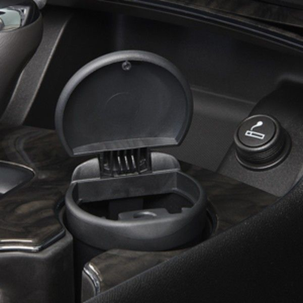 Corvette Smoker's Package, Front Floor Console Ashtray:Convenient for those who choose to smoke in their vehicle, this Smoker's Package fits perfectly into the standard cup holder and is easy to remove.