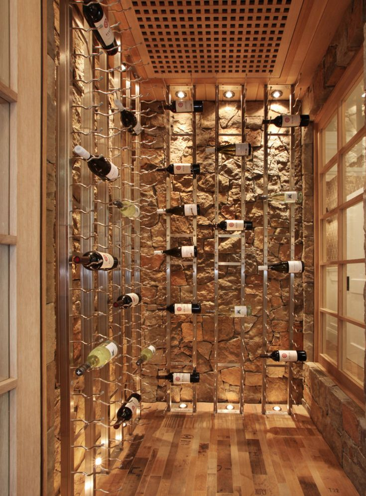 Our future wine storage room. Concrete/cellar-like floors with modern glass door entry.  Love!