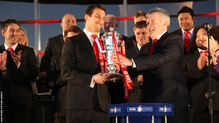 The First Minister of Wales Carwyn Jones presents Wales captain Sam Warburton with the Six Nations Trophy at the Senedd in Cardiff Bay