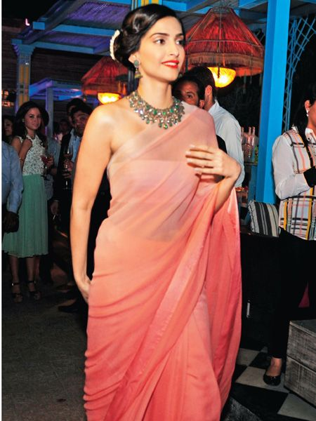 Sonam Kapoor: Wearing a peach shaded sari, Sonam Kapoor opted for a side bun hairstyle accessorised with white flowers. We like.
