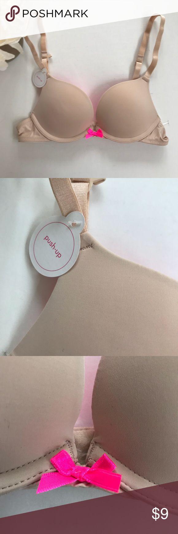 NWT-Xhilaration Nude Padded Wired Bra 32AA New with tags Xhilaration nude colored padded wired bra. Size 32AA. Perfect t-Shirt bra. Xhilaration Intimates & Sleepwear Bras