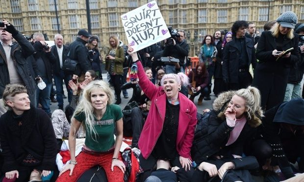 Face-sitting protest outside parliament against new porn rules. Sex workers and campaigners gather to demonstrate opposition to changes to UK pornography regulations