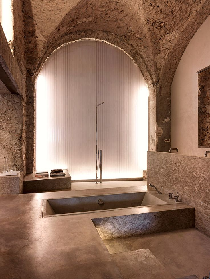 gus wstemann arranges nine apartments around rugged stone wall in zurich switzerlandspa designhome - Home Design Bathroom