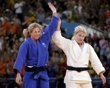 Kayla Harrison of the U.S. and Britain's Gemma Gibbons (blue) acknowledge the crowd after their women's -78kg final judo match at the London 2012 Olympic Games August 2, 2012. - http://www.PaulFDavis.com/success-speaker (info@PaulFDavis.com)