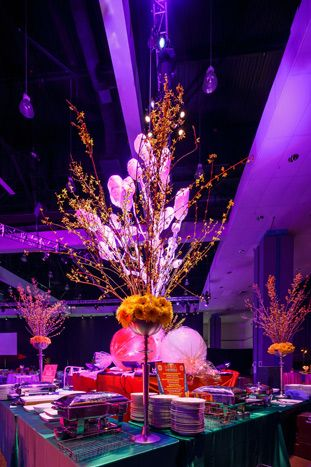 Oversize candy props and towering florals decorated buffet stations. Photo: Sean Twomey/2me Studios