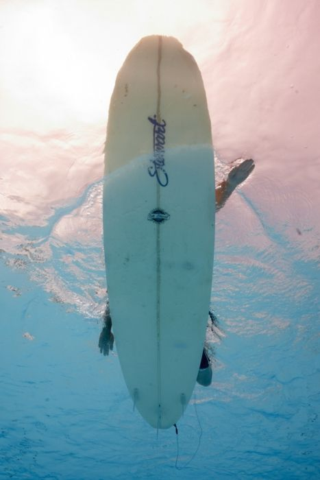 under the surfboard