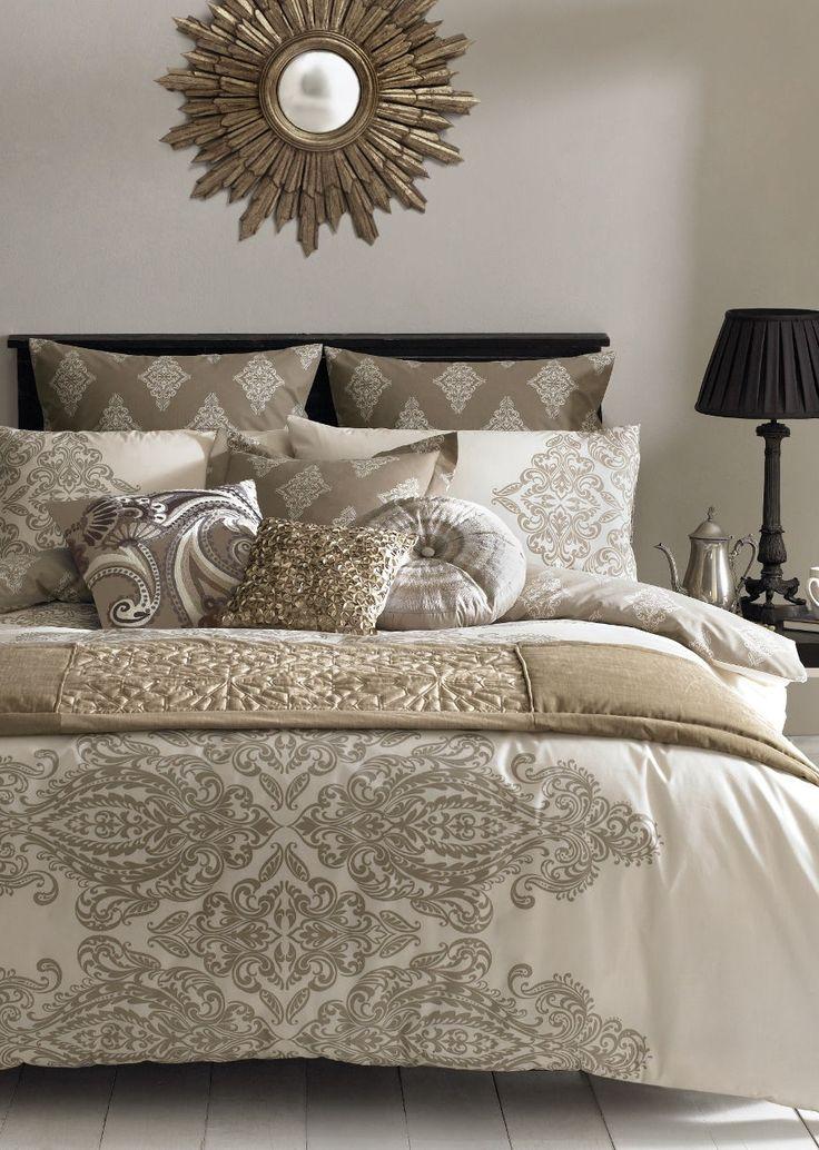 Elegant bedding in shades of beige and gold.  http://www.beddingworld.co.uk/p/Elizabeth_Hurley_Tobago_Duvet_Cover.htm