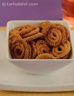 Baked chakli.  This simple and delicious recipe is a real treat for weight watchers. Chaklis, the popular indian snack, is usually deep-fried and contains loads of calories. Here's how to make them with 1 tsp of oil to near perfection by baking them in an oven. Munch them at anytime of the day when hunger strikes.