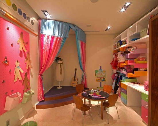 everything about this playroom is awesome for R...stage, dress up area, huge wall to hang up artwork! wow!