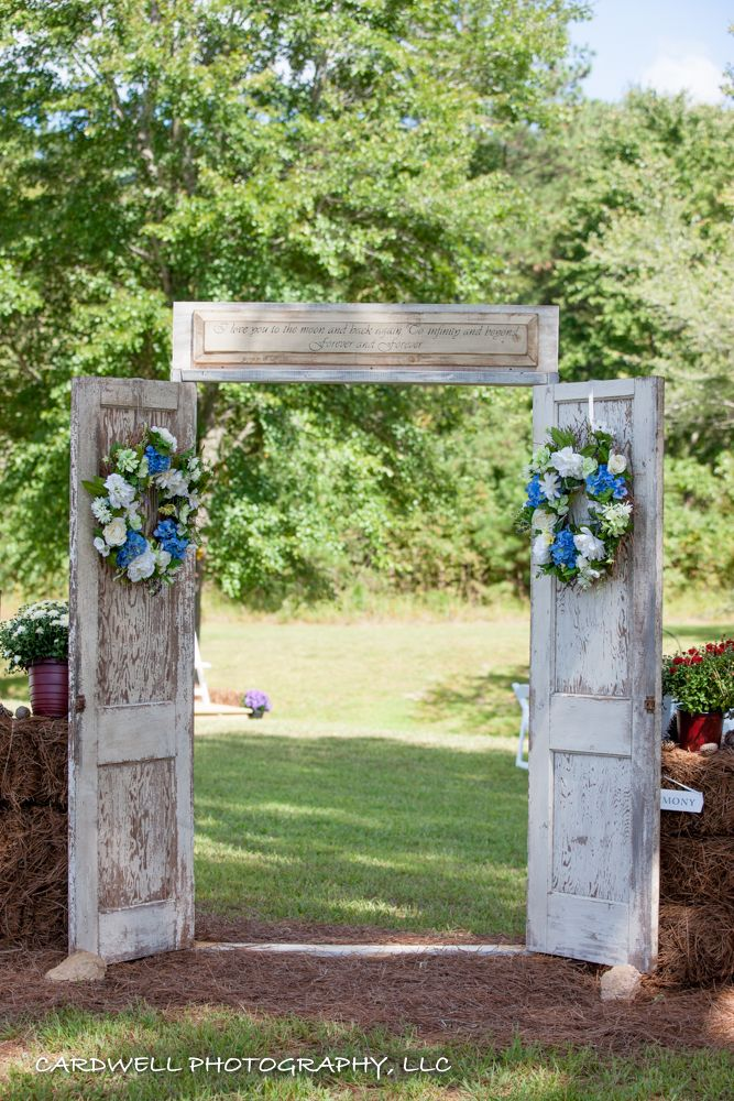 These antique doors  were found for $20 each and my husband made a frame to secure them together and I painted and distressed the frame to match the doors….Everyone remarked at how stunning they were as an entrance to the outdoor wedding ceremony!