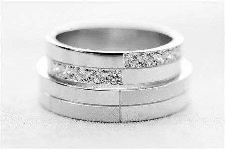 Geometrical bride and groom wedding rings with diamond detail